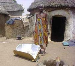Villagers like this woman in Zouzugu, Ghana, prevent dracunculiasis and other waterborne diseases by pasteurizing water in a solar cooker (Source: wikipedia, creator Tom Sponheim)