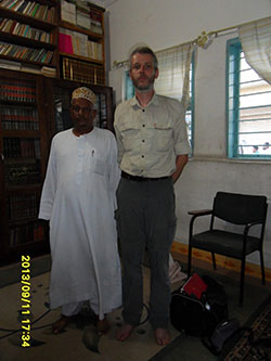 Mahmood Nurudin Hussein, spiritual leader of the Shadhiliyya brotherhood in his library