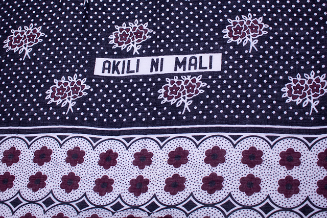 "Fragment of kanga with Swahili text ""Akili ni mali"" (Intelligence is wealth). (Source: Kanga Collection Textile Research Centre Leiden, Photo: Hans Splinter)"