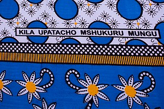 "Fragment of kanga with Swahili text ""Kila upatacho mshukuru mungu"" (Thank God for everything you get)."
