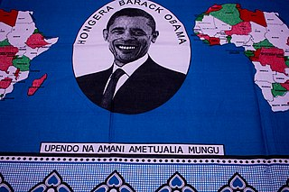 "Fragment of kanga from Tanzania. With Swahili texts: ""Upendo na amani ametujalia Mungu"" and ""Hongera Barack Obama"" (Love and peace have been granted us by God, and Congratulations Barack Obama)."